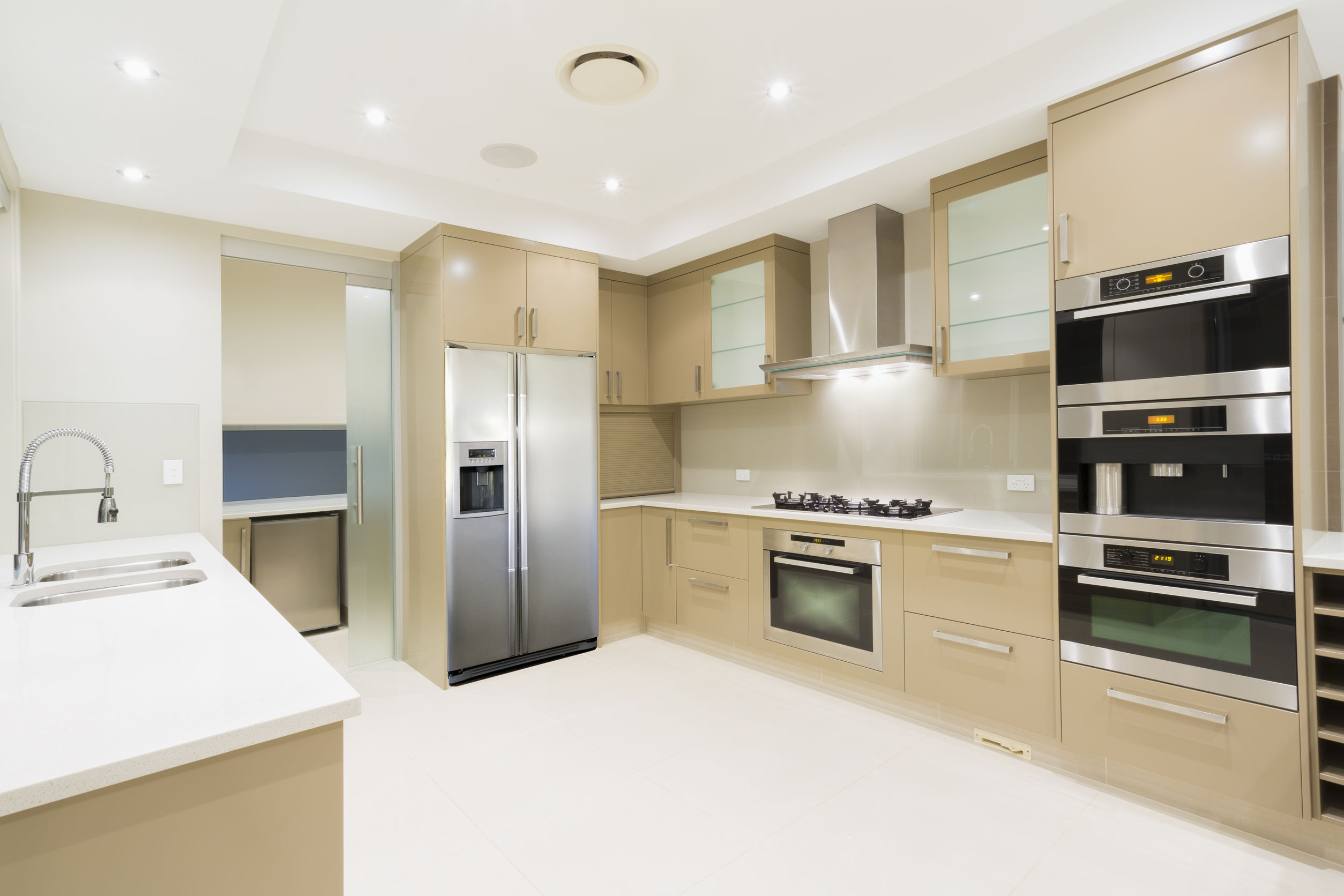 38740105 - modern kitchen with stainless steel appliances in australian mansion