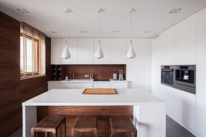 47778763 - white kitchen island in modern and wooden kitchen