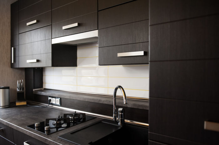 46556910 - beautiful brown kitchen in a modern style.