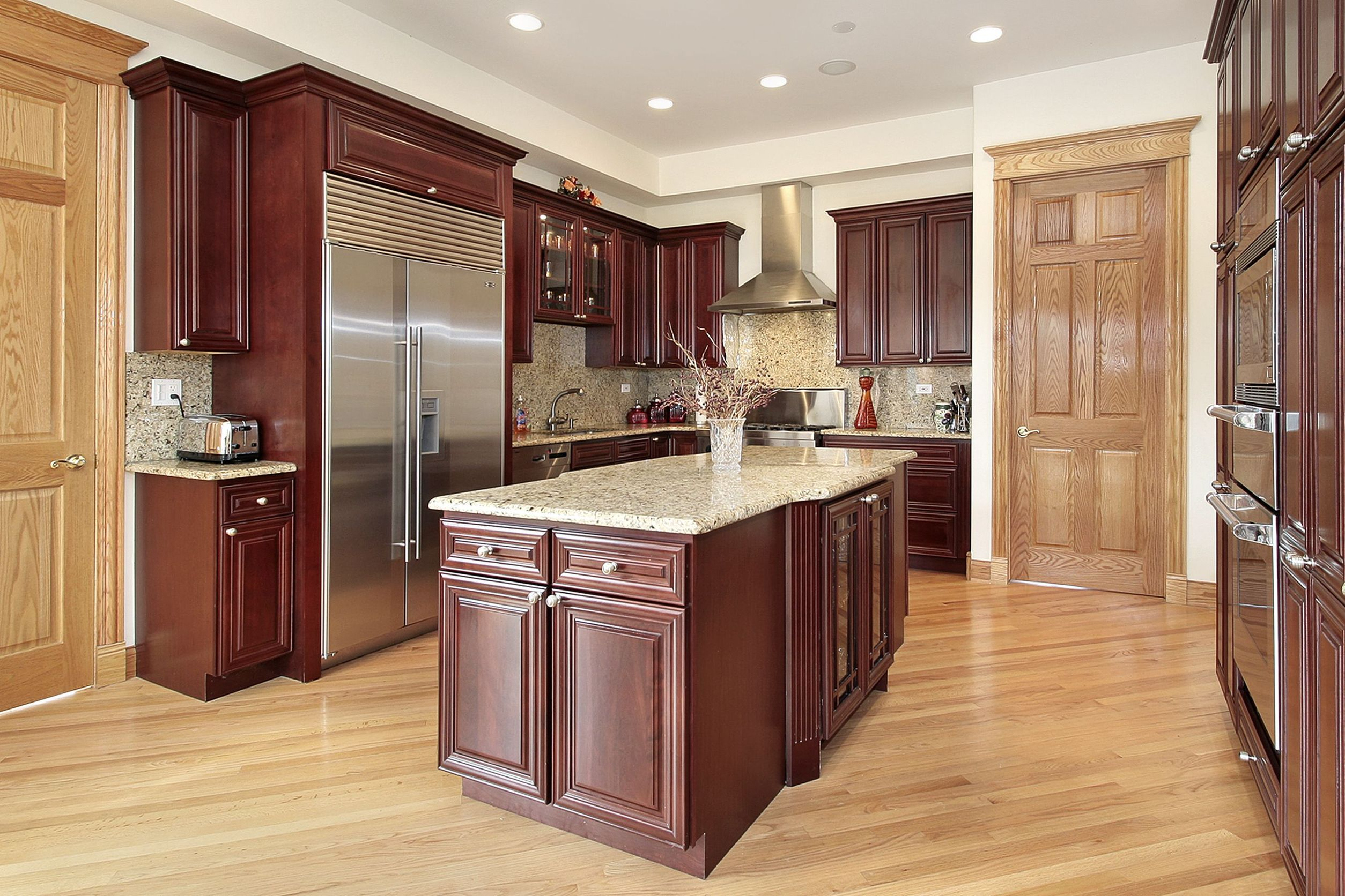 6739813 - kitchen in luxury home with cherry wood cabinetry